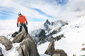 Mid adult man rock climbing, Chamonix, France