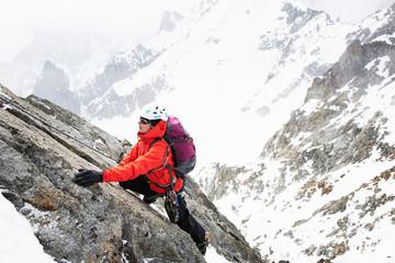 Mid adult woman mountain climbing, Chamonix, France