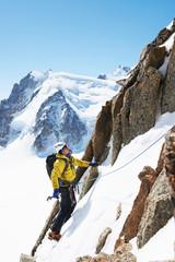 Mid adult man mountain climbing, Chamonix, France