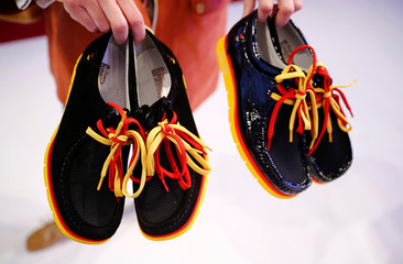 The male and female version of the official German Paralympic and Olympics shoes are seen during the country's uniforms presentation for the 2016 Rio Olympics in Duesseldorf