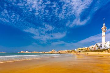 Fototapete - Playa de la Santamaria beach and Cathedral de Santa Cruz in the morning in Cadiz, Andalusia, Spain