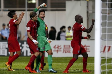 Hong Kong players acknowledge supporters after drawing against China in their 2018 World Cup qualifying soccer match in Hong Kong, China