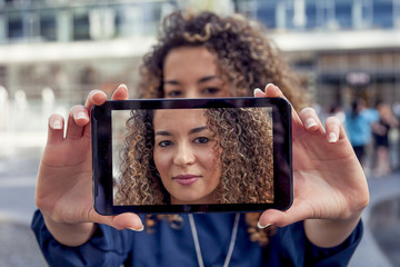 pretty young woman take a selfie with smart phone