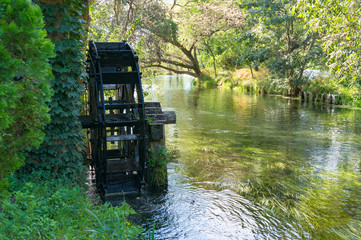 Water mill wheel on river