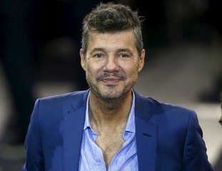 TV celebrity and vice-president of Argentina's soccer club San Lorenzo de Almagro Tinelli smiles during the AFA presidential election assembly in Buenos Aires