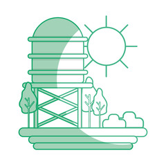 silhouette water tank with trees and sun