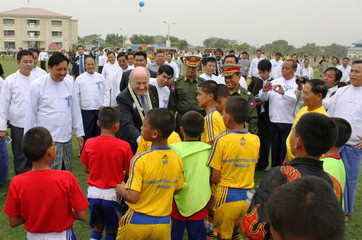 MANDALAY, March 15, 2011  International Federation of Association Football (FIFA) President Joseph S. Blatter (C) meets young players at the opening ceremony for the Youth Football Academy in Myanmar's second largest city, Mandalay on March 15, 2011. Mr. Blatter arrived here Tuesday afternoon on a two-day-visit in Myanmar to observe the facilities constructed under the arrangement of FIFA Goal Project.  (Xinhua/Lu Zihua) (Credit Image: © Lu Zihua/Xinhua/ZUMAPRESS.com)