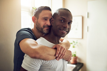 Alternative male couple smiling and hugging together