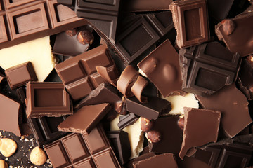 Heap of broken chocolate pieces, close up