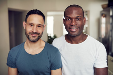 Multiethnic gay couple standing and looking at camera together