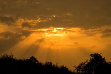 the sun rays illuminate the sky above the horizon (sunrise).