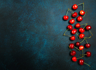 Sweet juicy cherries on blue eco concrete background. Top view, flat lay. healthy eating concept.
