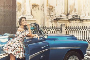 Beautiful woman and retro car