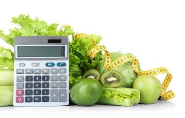Weight loss concept. Fresh vegetables, fruits, calculator and measuring tape on white background