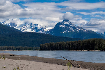 Snow-capped peaks over sandy riverbank of Lower Stikine river, Britsih Columbia, Canada