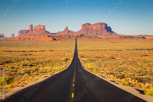 Wall mural Monument Valley with U.S. Highway 163 at sunset, Utah, USA