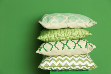 Stack of pillows on green background