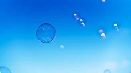 Soap bubbles. Blue sky as background.