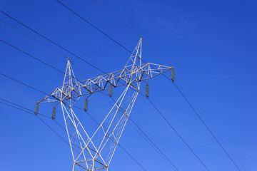 High voltage transmission line pylon. Copy space available.