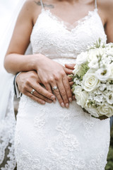 Bride and Groom Hands and Bouquet