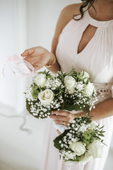 woman holding bouquets