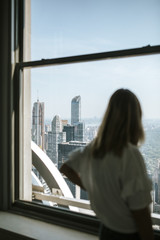 woman watching manhattans skyline