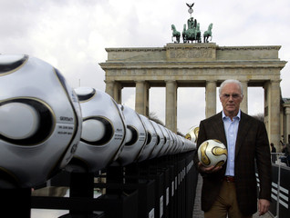 President of Germany's World Cup organising committee Beckenbauer holds a soccer ball in Berlin