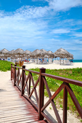 Fototapete - Wooden walkway leading to the shore at the beautiful Varadero beach in Cuba