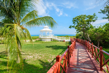 Wall Mural - Wooden walkway leading to the shore at Varadero beach in Cuba