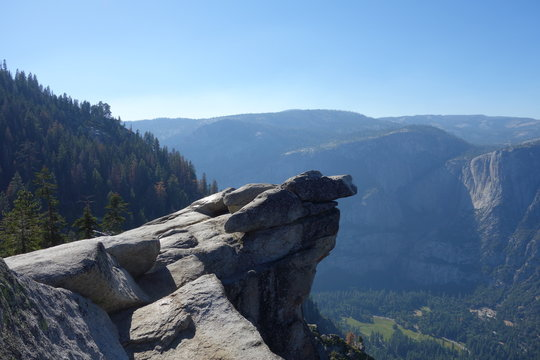 Scenic rocky cliff overlooking a vast landscape