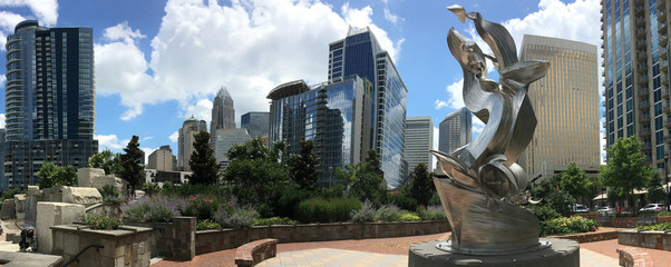 Panoramic view of downtown Charlotte, NC as seen from Romare Bearden Park Wall mural
