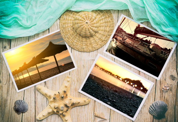 Summer photos on a wooden table with beach objects