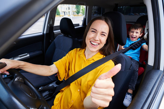 Smiling mum driving a car