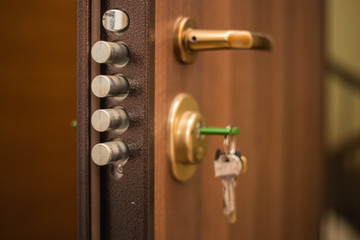 The keys in the lock of the door, on the outside, safety, locked doors, security, privacy