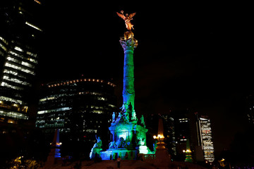 """The """"Angel de la Independencia"""" monument is seen lit in the colours of Brazil's flag in homage to 2016 Rio Olympics, in Mexico City"""