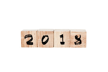 2018 on wooden cubes isolated on white background, new year concept