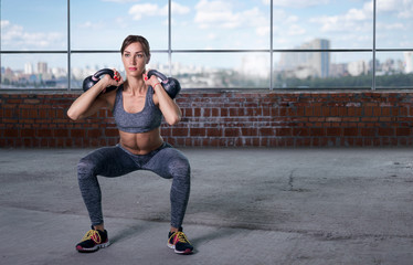 Woman athlete squat with weights. Copy space