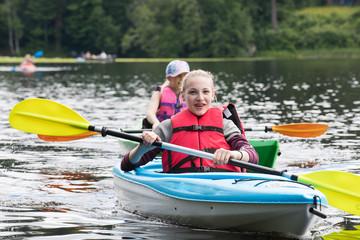 Young kids paddling on a kayak
