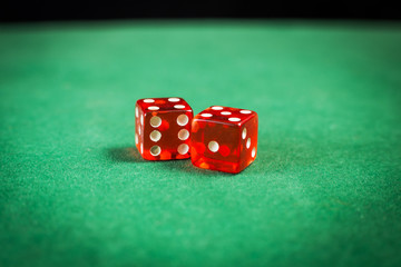 red dice over green surface image close up