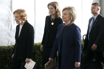 Former first lady Rosalynn Carter, Caroline Kennedy, and Hillary Clinton walk to the grave site after the funeral of Nancy Reagan at the Ronald Reagan Presidential Library in Simi Valley