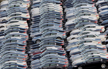 Jaguar cars are seen parked in rows at the Castle Bromwich plant in Birmingham, central England