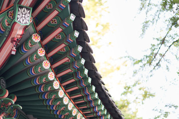 Korean traditional architecture eaves, blue sky at Gyeongbokgung Palace in Seoul, Korea.Amazing roof construcution without nail to weld the wood.