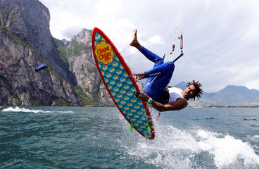 A kite surfer takes to the air while surfing on Garda Lake in northern Italy