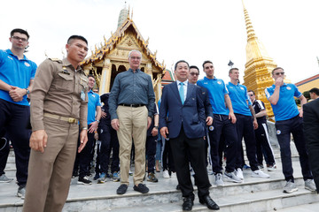Leicester City soccer club's manager Claudio Ranieri and club owner Vichai Srivaddhanaprabha visit the Emerald Buddha temple in Bangkok
