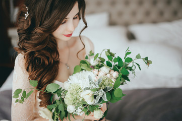 Bride with a beautiful bouquet of different colors. Close-up