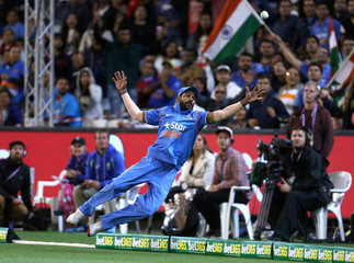 India's Shikhar Dhawan fails to stop a six from the batting of Australia's Aaron Finch during their T20 cricket match at the Melbourne Cricket Ground