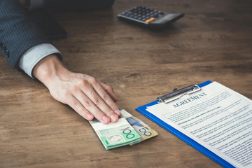 Businessman offer money while making an agreement