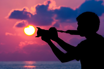 Silhouettes of photographers with the sunrise.