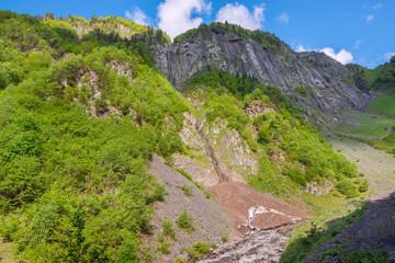 Beautiful waterfalls on a rocky mountain slope