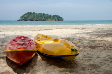 Two Kayaking on the beach.